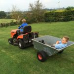 19-driving-his-friend-asher-on-the-tractor